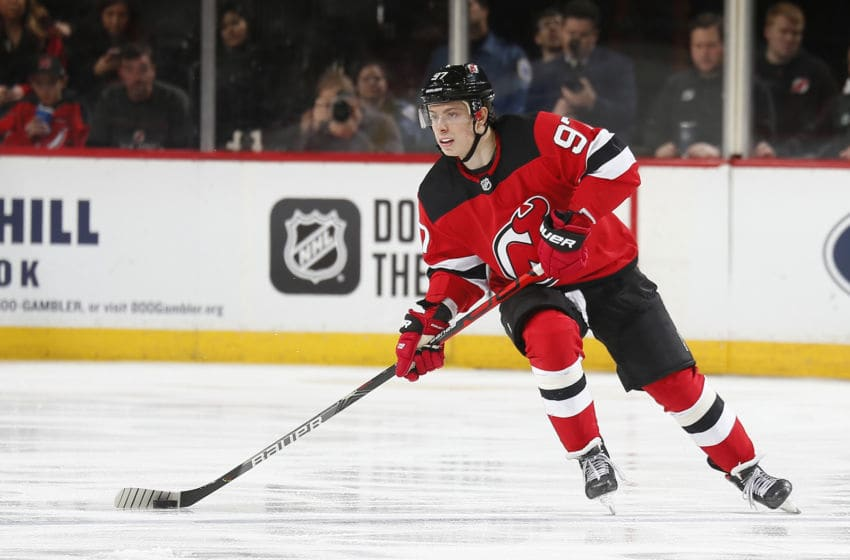 NEWARK, NJ - JANUARY 12: Nikita Gusev #97 of the New Jersey Devils plays the puck against the Tampa Bay Lightning during the game at the Prudential Center on January 12, 2020 in Newark, New Jersey. (Photo by Andy Marlin/NHLI via Getty Images)