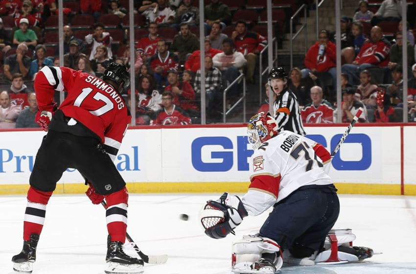 NEWARK, NJ - OCTOBER 14: Sergei Bobrovsky #72 of the Florida Panthers makes a save against Wayne Simmonds #17 of the New Jersey Devils during the third period on October 14, 2019 at the Prudential Center in Newark, New Jersey. The Panthers defeated the Devils 6-4. (Photo by Andy Marlin/NHLI via Getty Images)