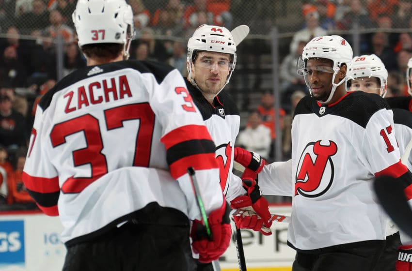 PHILADELPHIA, PA - FEBRUARY 06: Miles Wood #44 of the New Jersey Devils celebrates his third period goal against the Philadelphia Flyers with Pavel Zacha #37 and Wayne Simmonds #17 on February 6, 2020 at the Wells Fargo Center in Philadelphia, Pennsylvania. (Photo by Len Redkoles/NHLI via Getty Images)