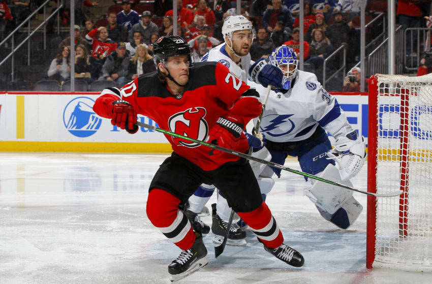 NEWARK, NEW JERSEY - JANUARY 12: Blake Coleman #20 of the New Jersey Devils in action against the Tampa Bay Lightning at Prudential Center on January 12, 2020 in Newark, New Jersey. The Devils defeated the Lightning 3-1. (Photo by Jim McIsaac/Getty Images)