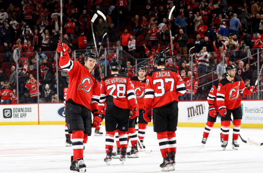 NEWARK, NEW JERSEY - FEBRUARY 08: Mirco Mueller #25 of the New Jersey Devils and the rest of the New Jersey Devils celebrate the shutout against the Los Angeles Kings at Prudential Center on February 08, 2020 in Newark, New Jersey.The New Jersey Devils defeated the Los Angeles Kings 3-0. (Photo by Elsa/Getty Images)
