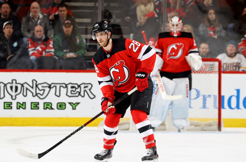 NEWARK, NEW JERSEY - FEBRUARY 08: Damon Severson #28 of the New Jersey Devils looks to pass in the second period against the Los Angeles Kings at Prudential Center on February 08, 2020 in Newark, New Jersey. (Photo by Elsa/Getty Images)