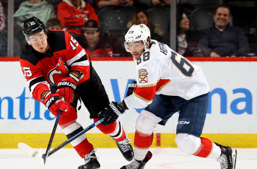 NEWARK, NEW JERSEY - FEBRUARY 11: Mike Hoffman #68 of the Florida Panthers and John Hayden #15 of the New Jersey Devils fight for the puck in the second period at Prudential Center on February 11, 2020 in Newark, New Jersey. (Photo by Elsa/Getty Images)