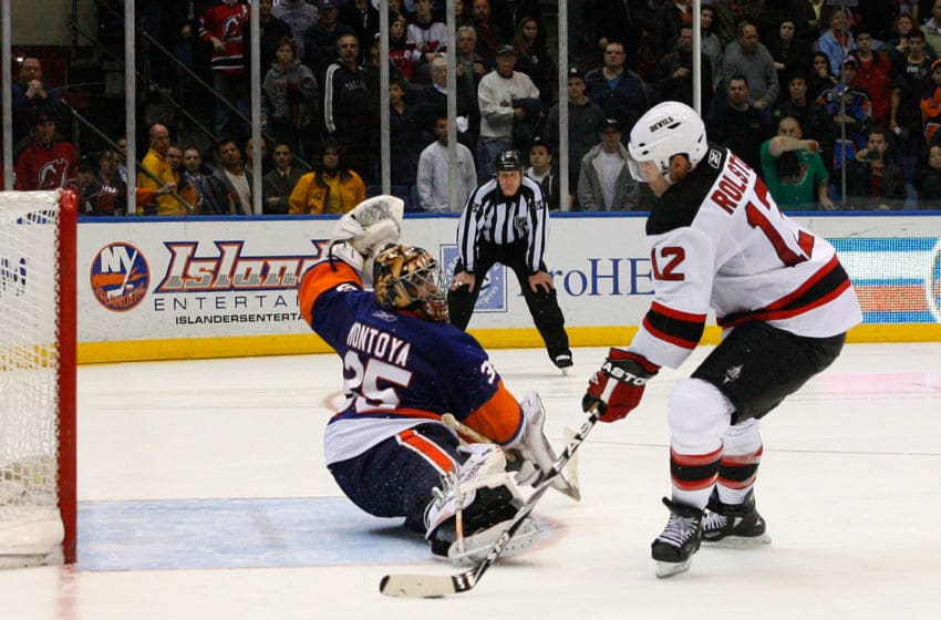 UNIONDALE, NY - MARCH 06: Brian Rolston #12 of the New Jersey Devils scores the game deciding goal in the shootout against Al Montoya #35 of the New York Islanders on March 6, 2011 at the Nassau Coliseum in Uniondale, New York. The Devils defeated the Islanders in a shootout 3-2. (Photo by Andy Marlin/AM Photography/Getty Images)
