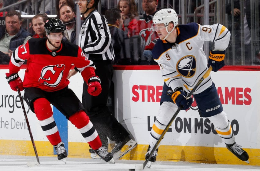NEWARK, NJ - MARCH 25: Jack Eichel #9 of the Buffalo Sabres in action against Pavel Zacha #37 of the New Jersey Devils at Prudential Center on March 25, 2019 in Newark, New Jersey. The Devils defeated the Sabres 3-1. (Photo by Jim McIsaac/Getty Images)