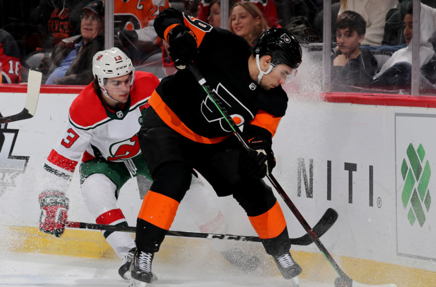 NEWARK, NEW JERSEY - MARCH 01: Ivan Provorov #9 of the Philadelphia Flyers tries to keep the puck from Nico Hischier #13 of the New Jersey Devils in the second period on March 01, 2019 at Prudential Center in Newark, New Jersey. (Photo by Elsa/Getty Images)