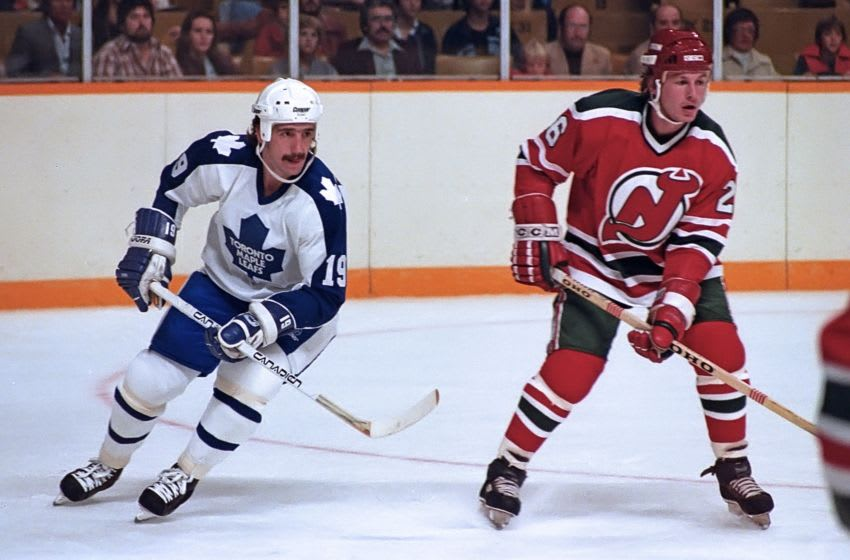 TORONTO, ON - OCTOBER 9: Bill Derlago #19 of the Toronto Maple Leafs and Mike Kitchen #26 of the New Jersey Devils skate up ice at Maple Leaf Gardens, Toronto, October 9, 1982, (Photo by Graig Abel Collection/Getty Images)