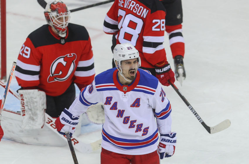 New York Rangers left wing Chris Kreider (20) celebrates his goal during the second period of their game against the New Jersey Devils at Prudential Center. Mandatory Credit: Ed Mulholland-USA TODAY Sports