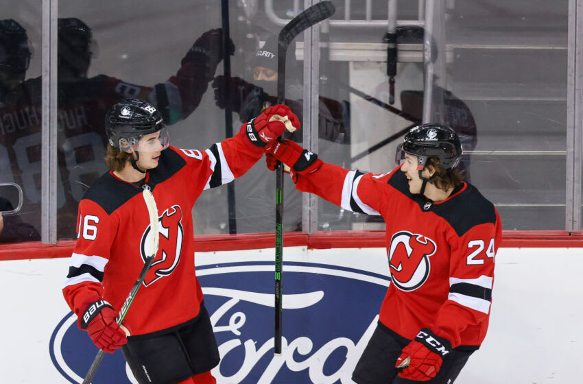 New Jersey Devils center Jack Hughes (86) celebrates his goal with defenseman Ty Smith (24) during the first period against the Pittsburgh Penguins at Prudential Center. Mandatory Credit: Vincent Carchietta-USA TODAY Sports