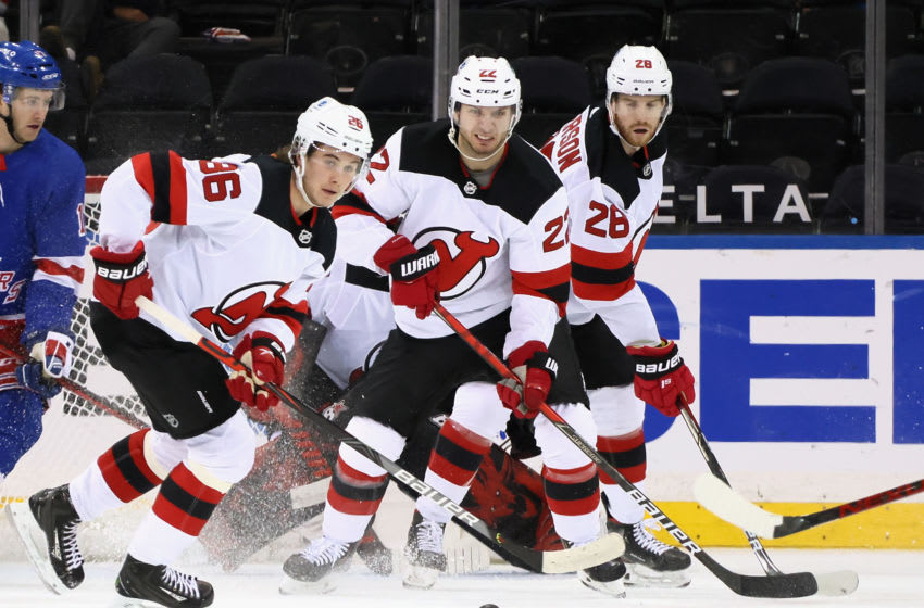 Jack Hughes #86, Ryan Murray #22 and Damon Severson #28 of the New Jersey Devils defend against the New York Rangers during the first period at Madison Square Garden. Mandatory Credit: POOL PHOTOS-USA TODAY Sports