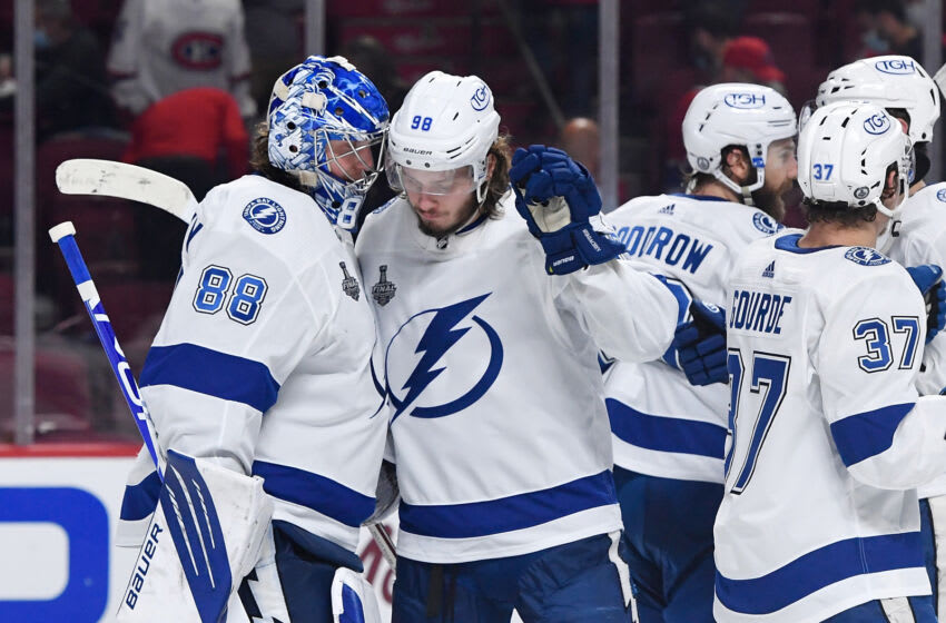 Tampa Bay Lightning goaltender Andrei Vasilevskiy (88) and defenseman Mikhail Sergachev (98) celebrate after the Lightning defeated the Montreal Canadiens in game three of the 2021 Stanley Cup Final at the Bell Centre. Mandatory Credit: Eric Bolte-USA TODAY Sports