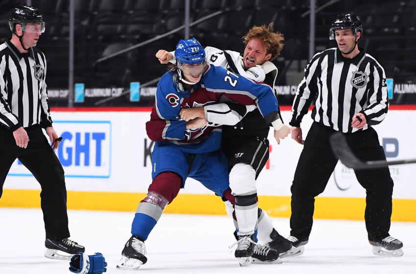 May 13, 2021; Denver, Colorado, USA; Los Angeles Kings left wing Brendan Lemieux (48) and Colorado Avalanche defenseman Ryan Graves (27) fight during the second period at Ball Arena. Mandatory Credit: Ron Chenoy-USA TODAY Sports