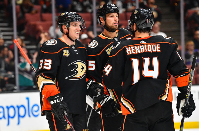 ANAHEIM, CA - SEPTEMBER 26: right wing Jakob Silfverberg (33) celebrates his goal with center Ryan Getzlaf (15) and centerAdam Henrique (14) during a NHL preseason game between the Los Angeles Kings and the Anaheim Ducks played on September 26, 2018 at the Honda Center in Anaheim, CA.