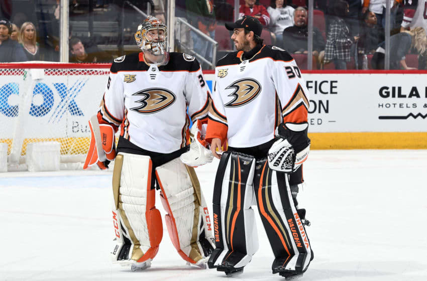 GLENDALE, AZ - OCTOBER 06: Goalies John Gibson #36 and Ryan Miller #30 of the Anaheim Ducks skate off the ice following a 1-0 victory against the Arizona Coyotes at Gila River Arena on October 6, 2018 in Glendale, Arizona. (Photo by Norm Hall/NHLI via Getty Images)