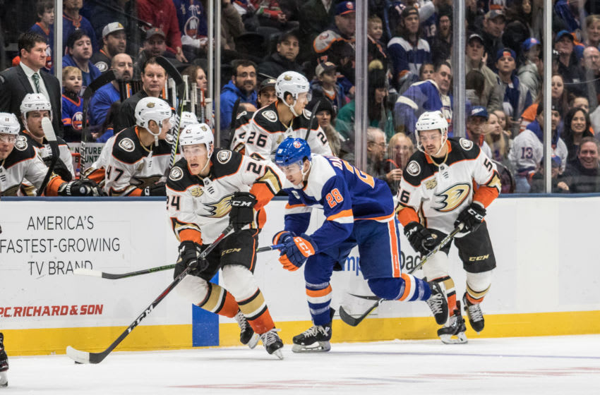 UNIONDALE, NY - JANUARY 20: Anaheim Ducks Center Carter Rowney (24) skates by New York Islanders Left Wing Michael Dal Colle (28) during the first period of a regular season NHL game between the Anaheim Ducks and the New York Islanders on January 20, 2019, at Nassau Veterans Memorial Coliseum in Uniondale, NY. (Photo by David Hahn/Icon Sportswire via Getty Images)