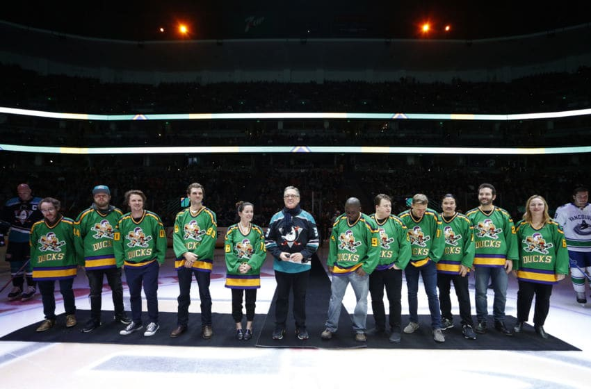 ANAHEIM, CA - FEBRUARY 13: Members of the cast and crew from the original Mighty Ducks movie line up for the ceremonial puck drop prior to the game between the Anaheim Ducks and the Vancouver Canucks on February 13, 2019 at Honda Center in Anaheim, California. (Photo by Debora Robinson/NHLI via Getty Images)