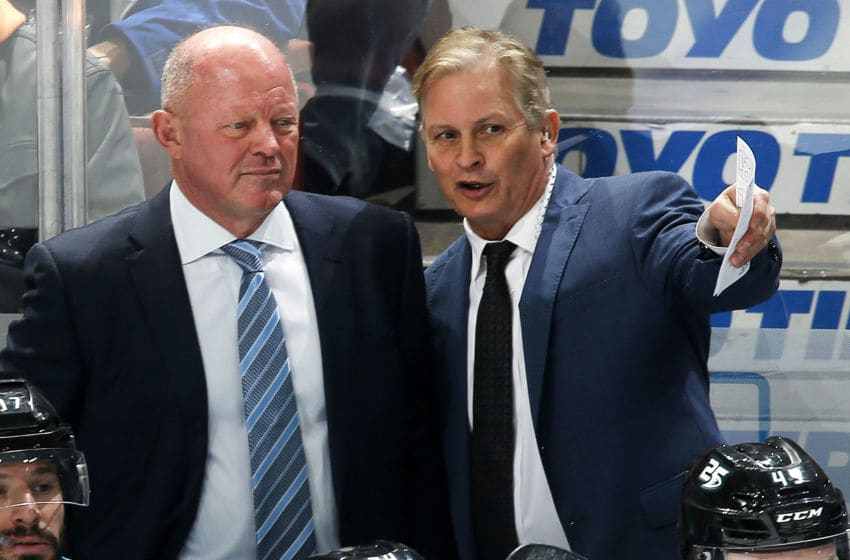 ANAHEIM, CA - FEBRUARY 13: Interim head coach of the Anaheim Ducks, Bob Murray, chats with assistant coach, Mark Morrison while coaching first NHL game on February 13, 2019 against the Vancouver Canucks at Honda Center in Anaheim, California. (Photo by Debora Robinson/NHLI via Getty Images)