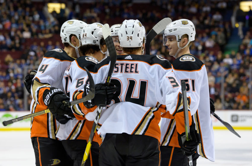 VANCOUVER, BC - MARCH 26: Anaheim Ducks Right Wing Kiefer Sherwood (64) is congratulated after scoring a goal against the Vancouver Canucks during their NHL game at Rogers Arena on March 26, 2019 in Vancouver, British Columbia, Canada. Anaheim won 5-4. (Photo by Derek Cain/Icon Sportswire via Getty Images)
