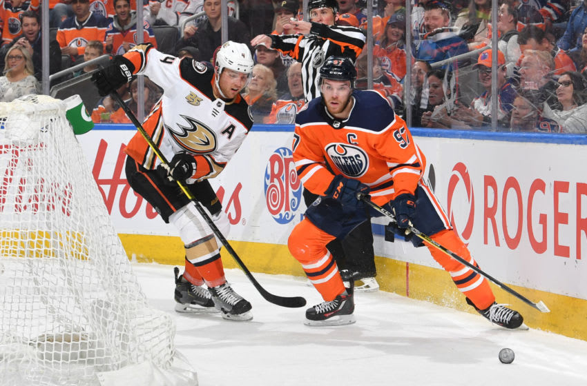 EDMONTON, AB - MARCH 30: Connor McDavid #97 of the Edmonton Oilers skates with the puck while being pursued by Cam Fowler #4 of the Anaheim Ducks on March 30, 2019 at Rogers Place in Edmonton, Alberta, Canada. (Photo by Andy Devlin/NHLI via Getty Images)