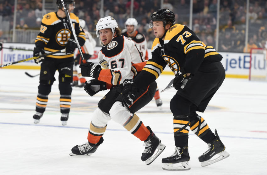 BOSTON, MA - OCTOBER 14: Rickard Rakell #67 of the Anaheim Ducks skates against Charlie McAvoy #73 of the Boston Bruins at the TD Garden on October 14, 2019 in Boston, Massachusetts. (Photo by Steve Babineau/NHLI via Getty Images)