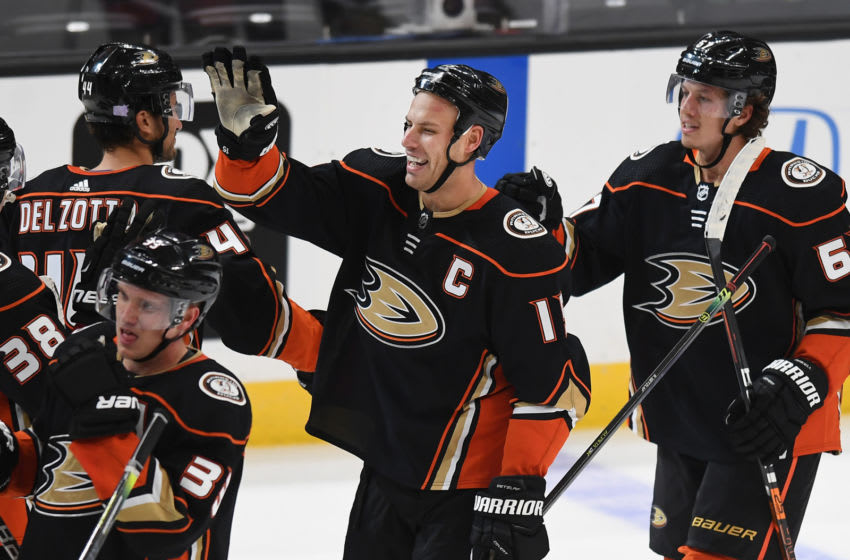 ANAHEIM, CA - NOVEMBER 01: Anaheim Ducks center Ryan Getzlaf (15) celebrates on the ice with teammates after Getzlaf scored the game winning goal in overtime to defeat the Vancouver Canucks 2 to 1 in a game played on November 1, 2019 at the Honda center in Anaheim, CA. (Photo by John Cordes/Icon Sportswire via Getty Images)