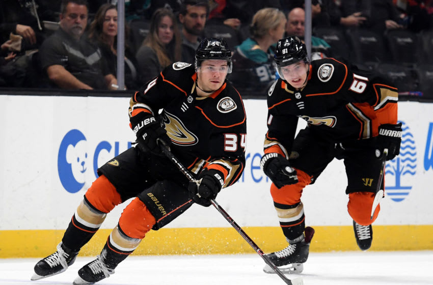 Sam Steel #34 of the Anaheim Ducks breaks out with Troy Terry #61 (Photo by Harry How/Getty Images)