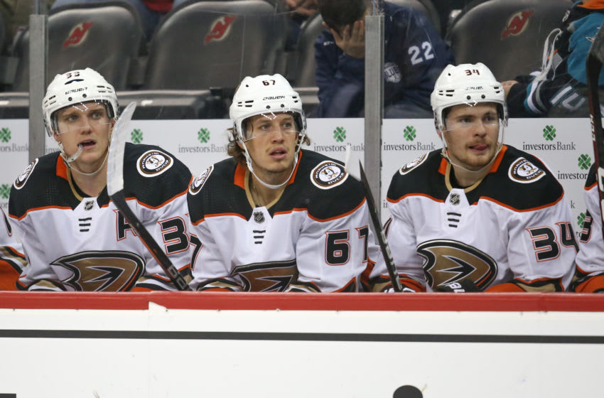 NEWARK, NJ - DECEMBER 18: Anaheim Ducks left wing Rickard Rakell (67) on the bench during the National Hockey League game between the New Jersey Devils and the Anaheim Ducks on December 18, 2019 at the Prudential Center in Newark, N J. (Photo by Rich Graessle/Icon Sportswire via Getty Images)