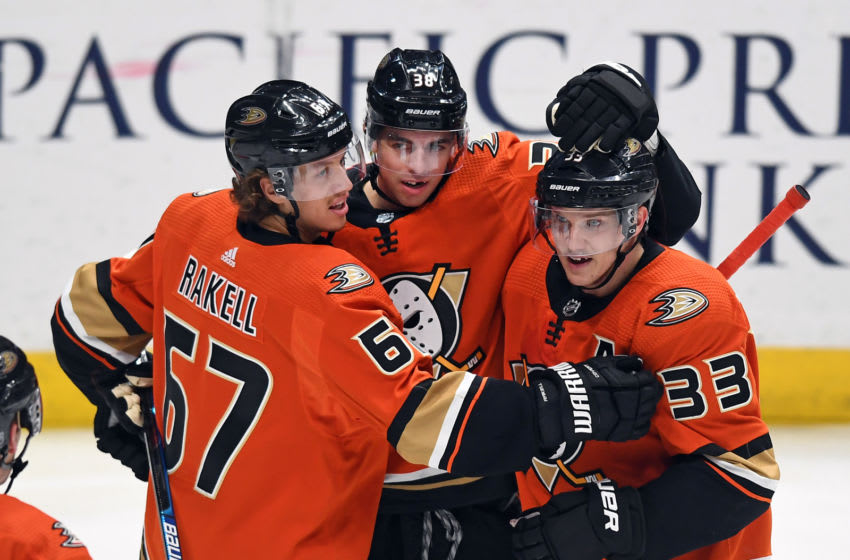 ANAHEIM, CA - DECEMBER 12: Anaheim Ducks center Derek Grant (38) with teammates after Grant scored a goal in the third period of a game against the Los Angeles Kings played on December 12, 2019 at the Honda Center in Anaheim, CA. (Photo by John Cordes/Icon Sportswire via Getty Images)