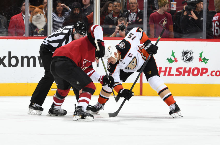 GLENDALE, ARIZONA - NOVEMBER 27: Ryan Getzlaf #15 of the Anaheim Ducks takes a face-off against the Arizona Coyotes at Gila River Arena on November 27, 2019 in Glendale, Arizona. (Photo by Norm Hall/NHLI via Getty Images)
