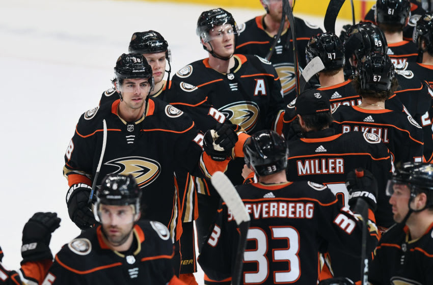 ANAHEIM, CA - JANUARY 29: Anaheim Ducks center Derek Grant (38) on the ice with his teammates after the Ducks defeated the Arizona Coyotes 4 to 2 in a game played on January 29, 2020 at the Honda Center in Anaheim, CA. (Photo by John Cordes/Icon Sportswire via Getty Images)