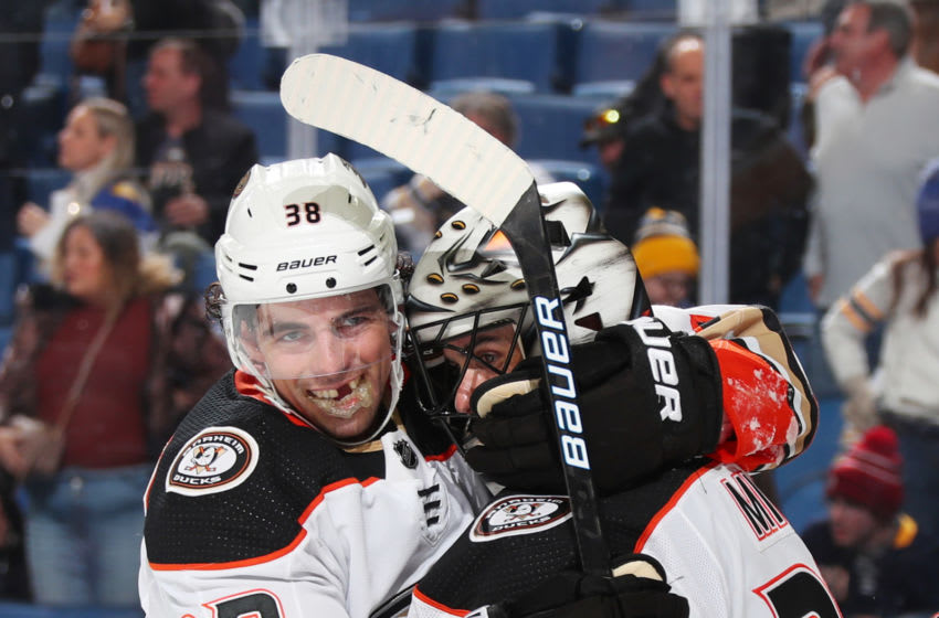 BUFFALO, NY - FEBRUARY 9: Derek Grant #38 and Ryan Miller #30 of the Anaheim Ducks celebrate a 3-2 victory against the Buffalo Sabres after an NHL game on February 9, 2020 at KeyBank Center in Buffalo, New York. (Photo by Bill Wippert/NHLI via Getty Images)