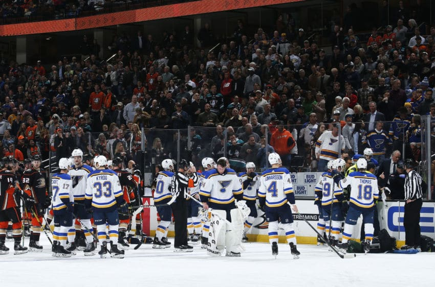 ANAHEIM, CA - FEBRUARY 11: The St. Louis Blues and the Anaheim Ducks watch as the paramedics tend to Jay Bouwmeester #19 of the St. Louis Blues after he collapsed on the bench during the first period of the game at Honda Center on February 11, 2020 in Anaheim, California. (Photo by Debora Robinson/NHLI via Getty Images)