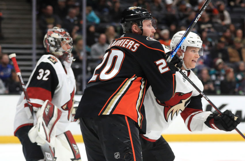 ANAHEIM, CALIFORNIA - JANUARY 29: Nicolas Deslauriers #20 of the Anaheim Ducks pushes Jakob Chychrun #6 of the Arizona Coyotes (Photo by Sean M. Haffey/Getty Images)