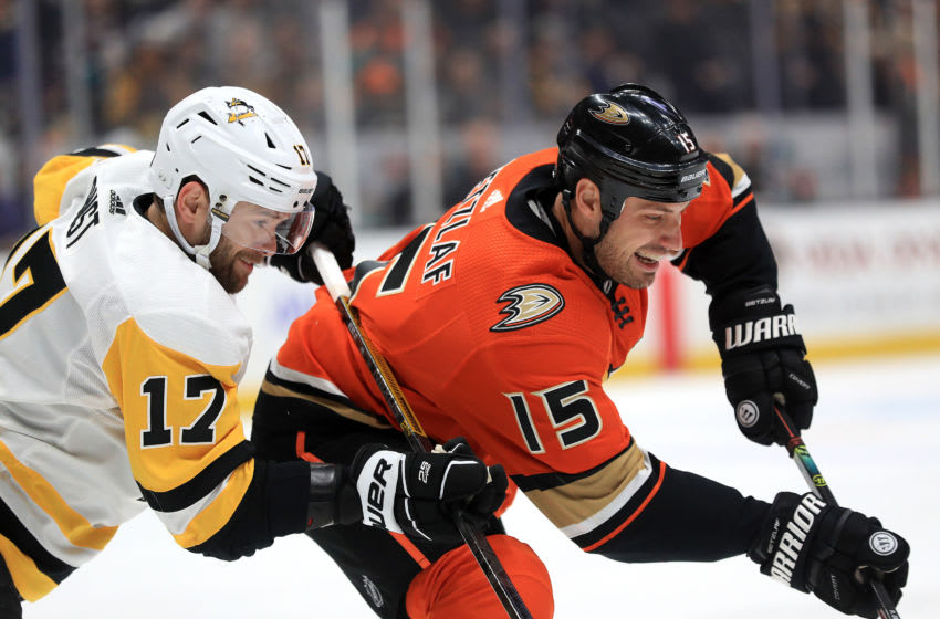 Bryan Rust #17 of the Pittsburgh Penguins battles Ryan Getzlaf #15 of the Anaheim Ducks (Photo by Sean M. Haffey/Getty Images)