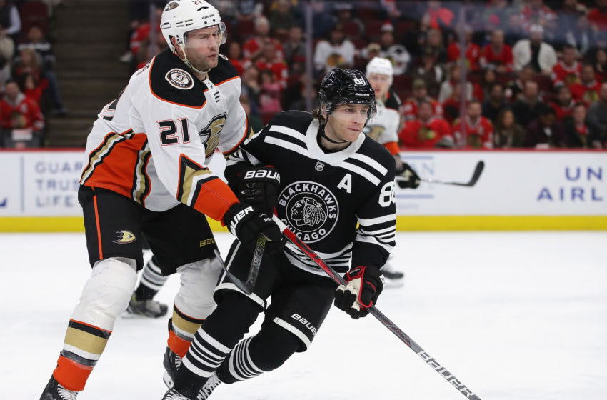Patrick Kane #88 of the Chicago Blackhawks skates to the puck under pressure from David Backes #21 of the Anaheim Ducks (Photo by Jonathan Daniel/Getty Images)