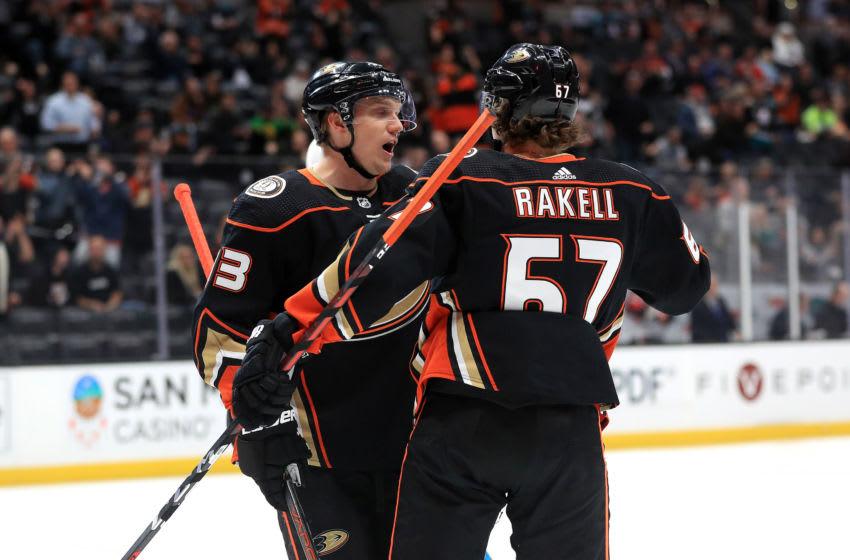 Rickard Rakell #67 congratulates Jakob Silfverberg #33 of the Anaheim Ducks (Photo by Sean M. Haffey/Getty Images)