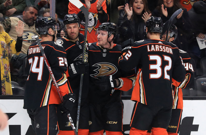ANAHEIM, CALIFORNIA - MARCH 10: Carter Rowney #24, Ryan Getzlaf #15, and Jacob Larsson #32 congratulate Nicolas Deslauriers #20 of the Anaheim Ducks after his goal during the first period of a game against the Ottawa Senators Honda Center on March 10, 2020 in Anaheim, California. Deslauriers scored a hat trick in the first period. (Photo by Sean M. Haffey/Getty Images)