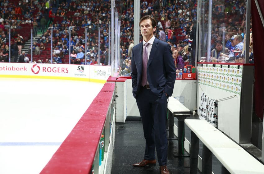 VANCOUVER, BC - OCTOBER 11: Head coach Dallas Eakins of the Edmonton Oilers looks on from the bench during their NHL game against the Vancouver Canucks at Rogers Arena October 11, 2014 in Vancouver, British Columbia, Canada. Vancouver won 5-4 in a shootout. (Photo by Jeff Vinnick/NHLI via Getty Images)