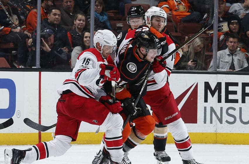 ANAHEIM, CA - DECEMBER 11: Ondrej Kase #25 of the Anaheim Ducks battles for position against Marcus Kruger #16 and Jaccob Slavin #74 of the Carolina Hurricanes during the game on December 11, 2017 at Honda Center in Anaheim, California. (Photo by Debora Robinson/NHLI via Getty Images)