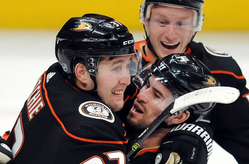 ANAHEIM, CA - JANUARY 17: Anaheim Ducks leftwing Nick Ritchie (37) leaps into the arms of center Adam Henrique (14) after Henrique scored a goal in the second period of a game against the Pittsburgh Penguins played on January 17, 2018 at the Honda Center in Anaheim, CA. (Photo by John Cordes/Icon Sportswire via Getty Images)