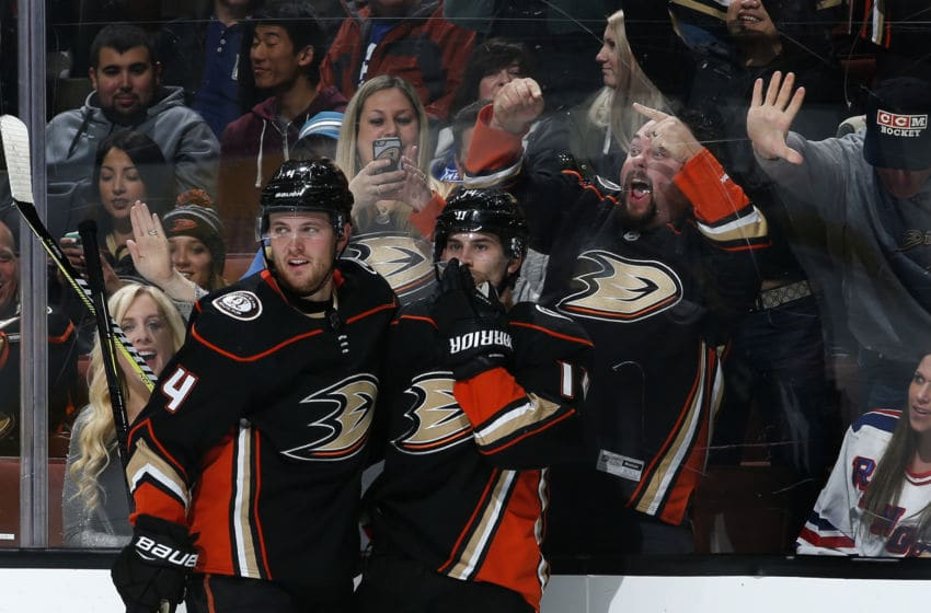 ANAHEIM, CA - JANUARY 23: Cam Fowler #4 and Adam Henrique #14 of the Anaheim Ducks celebrate a goal in the first period of the game against the New York Rangers on January 23, 2018 at Honda Center in Anaheim, California. (Photo by Debora Robinson/NHLI via Getty Images)