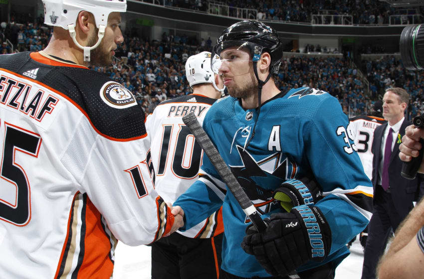 SAN JOSE, CA - APRIL 18: Ryan Tetzlaff #15 of the Anaheim Ducks shakes hands with Logan Couture #39 of the San Jose Sharks in Game Four of the Western Conference First Round during the 2018 NHL Stanley Cup Playoffs at SAP Center on April 18, 2018 in San Jose, California. (Photo by Rocky W. Widner/NHL/Getty Images) *** Local Caption *** Ryan Tetzlaff; Logan Couture