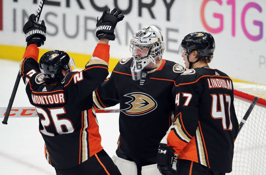 ANAHEIM, CA - MARCH 06: Anaheim Ducks goalie John Gibson (36) is greeted by defenseman Brandon Montour (26) and defenseman Hampus Lindholm (47) after the Ducks defeated the Washington Capitals 4 to 0 in a game played on March 6, 2018. (Photo by John Cordes/Icon Sportswire via Getty Images)