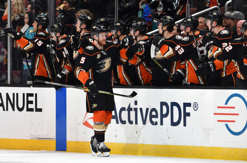 ANAHEIM, CA - APRIL 05: Anaheim Ducks defenseman Korbinian Holzer (5) is greeted by his teammates after Holzer scored a goal during the second period of a game against the Los Angeles Kings played on April 5, 2019 at the Honda Center in Anaheim, CA. (Photo by John Cordes/Icon Sportswire via Getty Images)