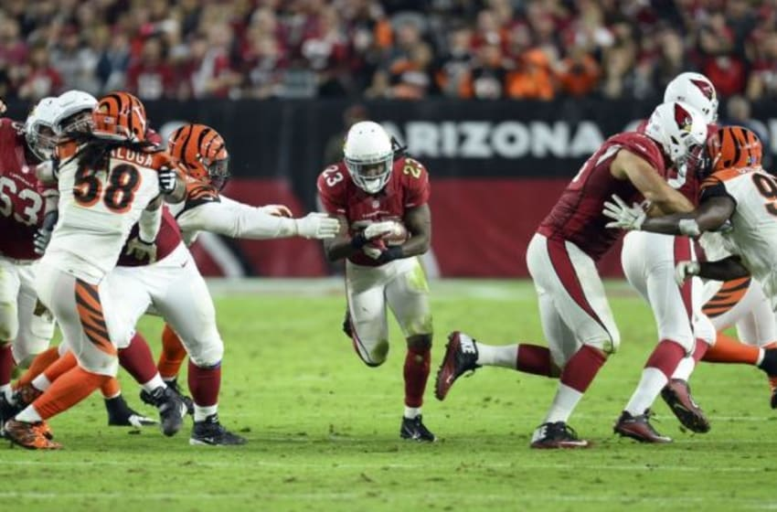 Nov 22, 2015; Glendale, AZ, USA; Arizona Cardinals running back Chris Johnson (23) runs the ball against the Cincinnati Bengals during the second half at University of Phoenix Stadium. The Cardinals won 34-31. Mandatory Credit: Joe Camporeale-USA TODAY Sports
