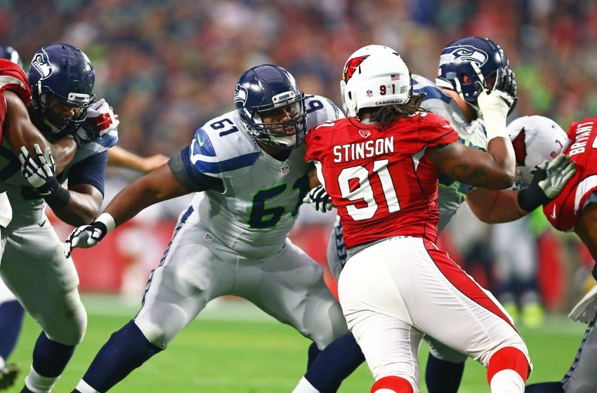 Jan 3, 2016; Glendale, AZ, USA; Seattle Seahawks center Lemuel Jeanpierre (61) against Arizona Cardinals defensive end Ed Stinson (91) at University of Phoenix Stadium. Mandatory Credit: Mark J. Rebilas-USA TODAY Sports