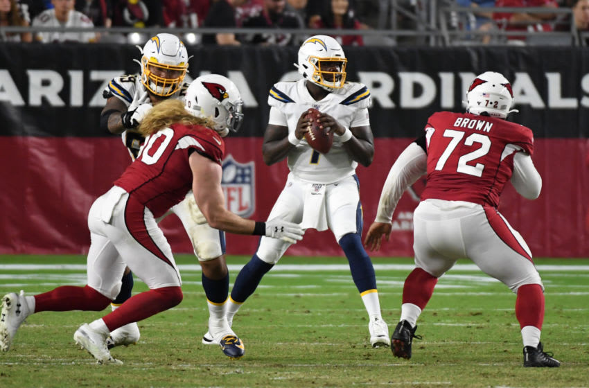 GLENDALE, ARIZONA - AUGUST 08: Cardale Jones #7 of the Los Angeles Chargers looks to throw the ball against the Arizona Cardinals during the first half of an NFL preseason game at State Farm Stadium on August 08, 2019 in Glendale, Arizona. (Photo by Norm Hall/Getty Images)