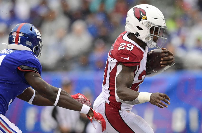 EAST RUTHERFORD, NEW JERSEY - OCTOBER 20: Chase Edmonds #29 of the Arizona Cardinals runs the ball past Michael Thomas #31 of the New York Giants for a touchdown during the first half at MetLife Stadium on October 20, 2019 in East Rutherford, New Jersey. (Photo by Steven Ryan/Getty Images)