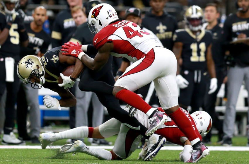 NEW ORLEANS, LOUISIANA - OCTOBER 27: Michael Thomas #13 of the New Orleans Saints runs is tackled by Haason Reddick #43 of the Arizona Cardinals during a NFL game at the Mercedes Benz Superdome on October 27, 2019 in New Orleans, Louisiana. (Photo by Sean Gardner/Getty Images)