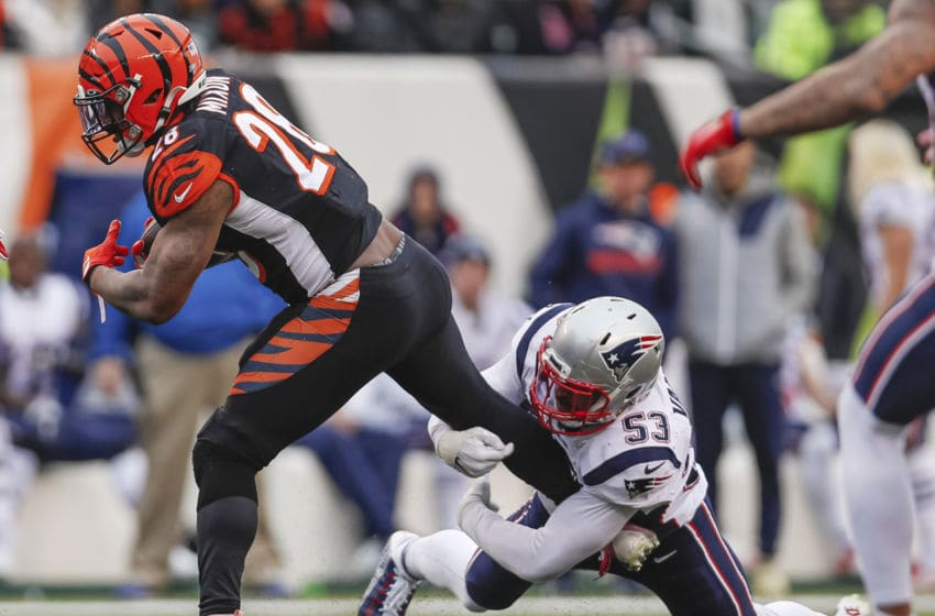 CINCINNATI, OH - DECEMBER 15: Joe Mixon #28 of the Cincinnati Bengals runs the ball as Kyle Van Noy #53 of the New England Patriots hangs on for the tackle during the second half at Paul Brown Stadium on December 15, 2019 in Cincinnati, Ohio. (Photo by Michael Hickey/Getty Images)